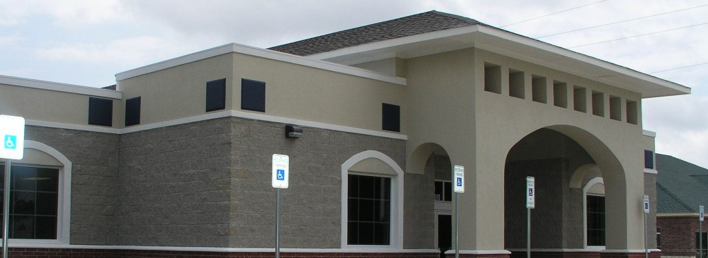 Mansfield Physical Therapy Commercial Construction Exterior With Parking lot signs